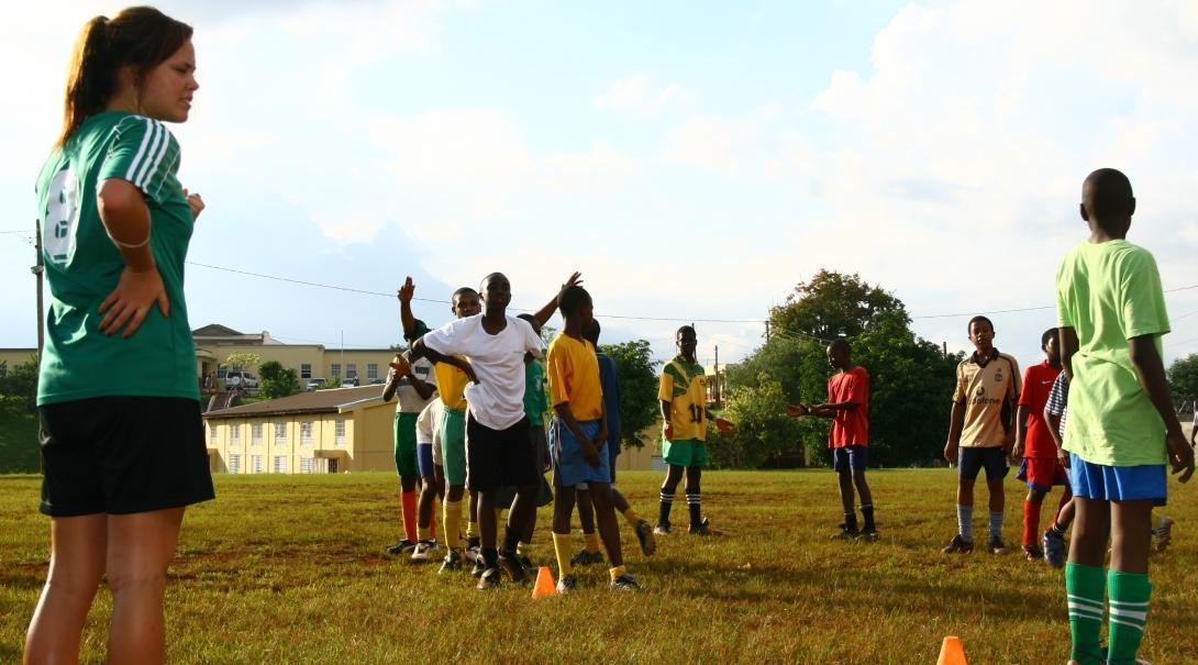 Players practise football drills through Projects Abroad's volunteer sports coaching in schools in Jamaica